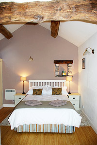Image: Swallow Barn Derbyshire luxury holiday cottage bedroom.